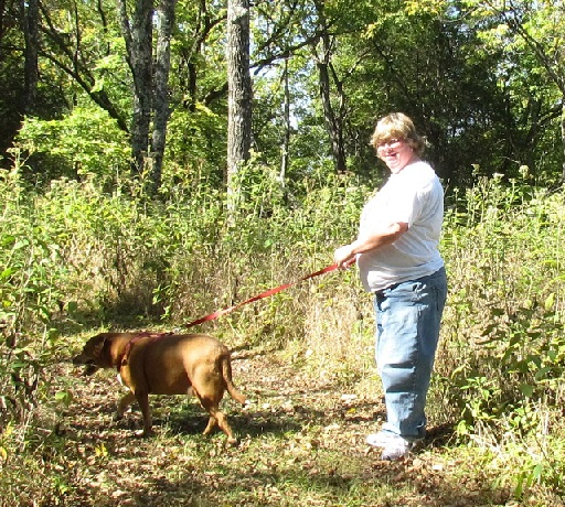 Molly and Barbara walking a trail through the woods at Fort Hill, Frankfort, KY