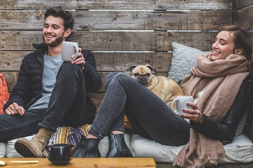 Young couple relaxing with their dog